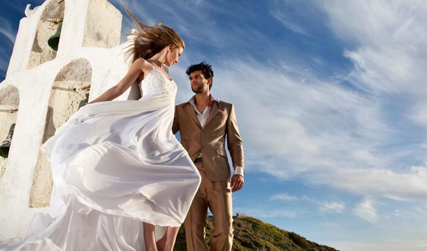 Символическая свадебная церемония на Andronis Luxury Suites в Греции на острове Санторини